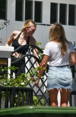 Dakota Fanning Talks with her friends outside her house in Studio City