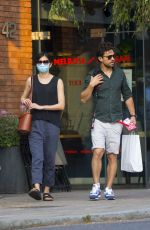 Dominic Cooper beams as he takes his girlfriend Gemma Chan shopping in London
