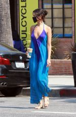 Eiza Gonzalez Seen in a beautiful flowing tie-dye blue jumpsuit while getting her caffeine fix at Alfred in Los Angeles