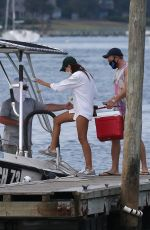 Emily Ratajkowski Are seen getting on a large boat in Long Island, New York