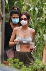 Emily Ratajkowski Getting take out at a local restaurant in the Hamptons