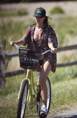 Emily Ratajkowski Photographed playing football at the beach in East Hampton Hamptons, New York after going for a bike ride