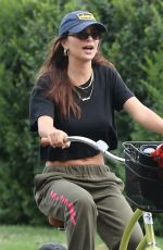 Emily Ratajkowski Rides her bike to the beach with friends in the Hamptons
