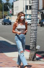Hailey Bieber In Tank top and jeans out in Beverly Hills