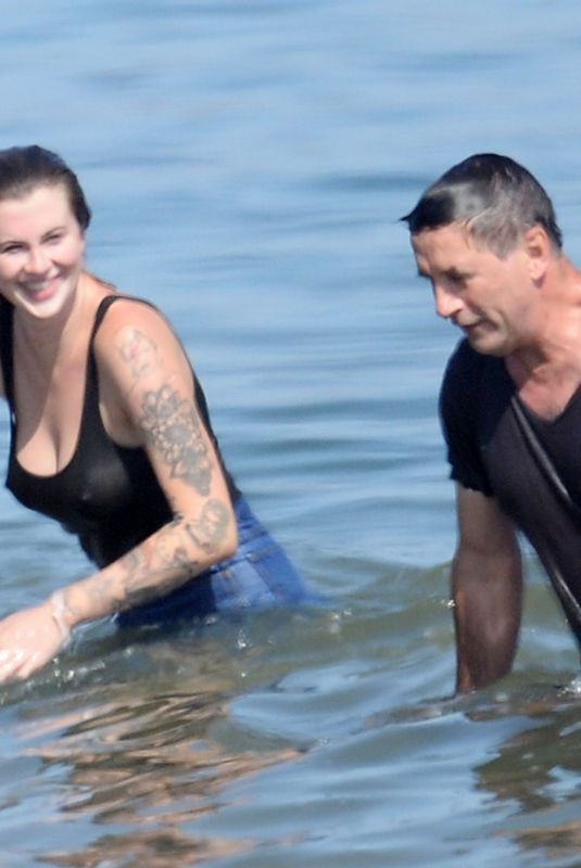 Ireland Baldwin At the beach with her uncle in Malibu