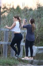 Jennifer Lopez Looks stunning as she goes make up free while posing for sunset portraits on a bike ride to the beach in Hamptons