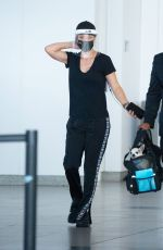 Kaley Cuoco At JFK Airport as she arrives in New York to finish filming