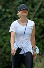 Kaley Cuoco Out for a walk in the Hamptons