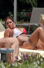Katie Price Showing off her Bikini body in a designer Bikini while relaxing poolside at their hotel in Turkey