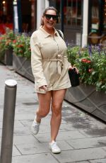 Kelly Brook Looks sporty in cream playsuit at Heart Radio Studios in London