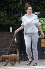 Kelly Brook Proves to be a good dog owner as she take Teddy for a low key walk in Promrose Hill