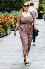 Kelly Brook Wearing a jumpsuit at Heart Radio in London