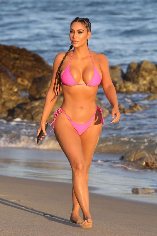 Kim Kardashian  On the beach posing for a KKW beauty photoshoot in Cabo San Lucas