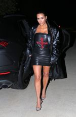 Kim Kardashian West In a black leather outfit as she leaves a friend