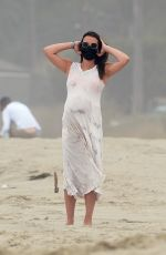 Lea Michele Cradles her growing baby bump while on the beach in Santa Monica