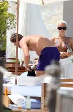 Lewis Burton and Lottie Tomlinson seen during their holiday in Ibiza after they recently confirmed their romance