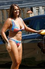 Malin Andersson Wore a floral skimpy little bikini and tried to cool down by washing a car