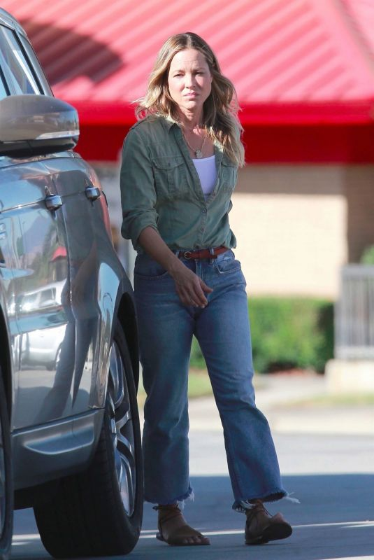 Maria Bello Fueling up her Range Rover at a gas station in Studio City