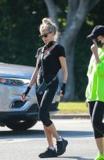Melanie Griffith Goes out for a walk with a friend in Beverly Hills