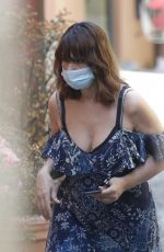 Monica Bellucci Wearing a protective face mask while shopping in Bellagio