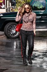 Myleene Klass Pictured at Smooth radio in leopard print sheer top and boots in London