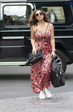 Myleene Klass Pictured at Smooth radio wearing a belted floral dress in London