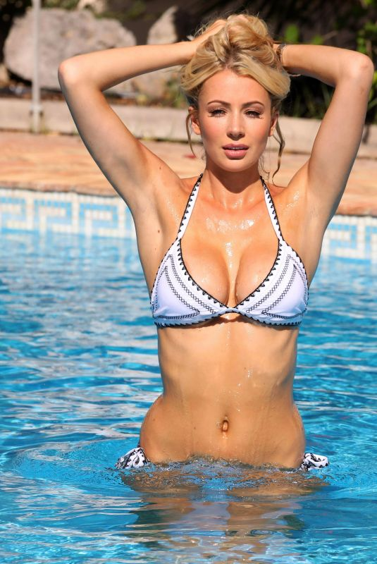 Olivia Attwood In bikini by the pool on Mykonos