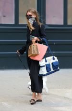 Olivia Palermo Pictured taking her dog Mr Butler out for a walk to the park in Dumbo, Brooklyn