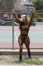 Phoebe Price Dons animal print while exercising at the tennis court in Los Angeles