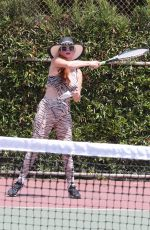 Phoebe Price Seen at the tennis courts as she stretches out and prepares to hit with her coach in Los Angeles