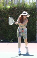 Phoebe Price Seen on the tennis courts wearing a newspaper print outfit as she hits balls in Los Angeles
