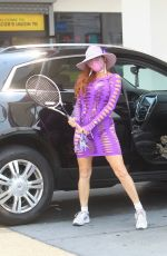 Phoebe Price Works on her tennis game at a gas station in Hollywood