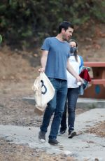 Rachel McAdams Shows her growing baby bump while out to a park with partner Jamie Linden in Los Angeles