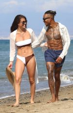 Rebecca Gormley and Biggs Chris are seen on the beach in Marbella