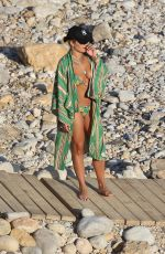 Rita Ora Enjoying a refreshing dip in the sea while on her summer holiday in Ibiza