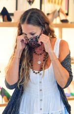 Sarah Jessica Parker Is a hands on owner as she is seen working the floor inside her shoe store in New York