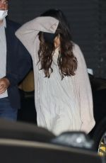 Selena Gomez Walks behind a friend avoiding cameras after a dinner party at Nobu in Malibu