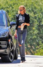 Stella Maxwell Stops for two bags of chips and a drink before retuning home in Los Angeles