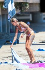 Tina Louise Cooling off on a hot day at the beach with friends in Malibu