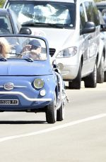 Victoria Silvstedt Cruising the streets of Sardinia in a Fiat 750 Oldtimer