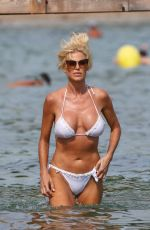 Victoria Silvstedt In a swimsuit on the beach at Jardin Tropezina in Saint-Tropez