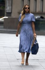 Vogue Williams Flashes post baby body in blue summer dress returns to work in London