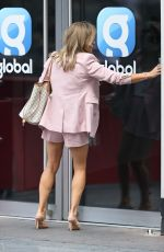 Zoe Hardman Stuns in a pink short suit showing incredible legs as she strolls through Leicester Square