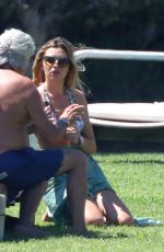 Abbey Clancy Displays her washboard abs in a frilly bikini in Sardinia