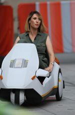 Alex Jones Film segments of The One Show driving Sinclair C5 vehicles in London