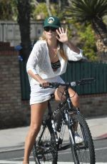 Ali Larter Looks cute in white while out enjoying an afternoon bike ride around the neighborhood in Brentwood