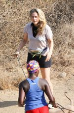Alicia Silverstone Is all smiles while out enjoying a hike with her dogs and a friend in Los Angeles