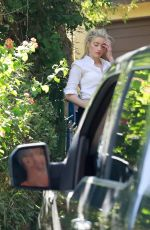 Amber Heard Arriving home with her dog in Los Angeles