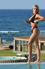 Amber Turner Takes selfies and enjoys the sun by the pool in Crete, Greece