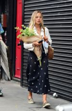 Amelia Windsor Holding a bouquet of flowers out in London